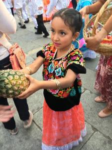 This precious little girl gave me a pineapple. She is absolutely adorable.